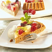 Three pieces of fruit flan with cream