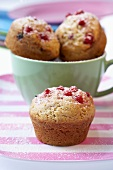 Redcurrant muffins in and in front of a cup