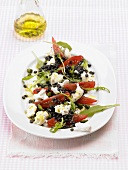 Salad leaves with goat's cheese, Beluga lentils & tomatoes