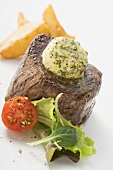 Beef fillet steak with herb butter and accompaniments