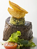 Beef fillet with herb butter, potato wedges, salad garnish