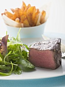 Beef fillet, a piece cut off, with salad & potato wedges