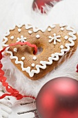 Gingerbread heart surrounded by Christmas decorations