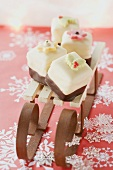 Petit fours on small sleigh (for Christmas)