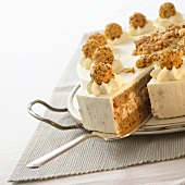 Hazelnut cake with cream and nut balls