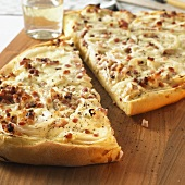 Tarte flambée with onion and bacon topping