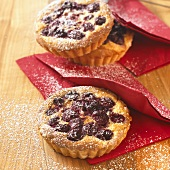 Cherry tarts dusted with icing sugar