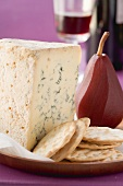 Blue Stilton, crackers, red wine pear and red wine