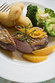 Duck breast with orange, potato croquettes and broccoli