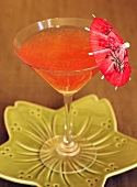 Rhubarb drink with cocktail umbrella