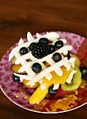 Fruit salad with cream lattice