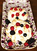 Ice cream with baked meringue topping and fresh berries