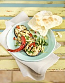 Grilled aubergine slices with chillies and flatbread