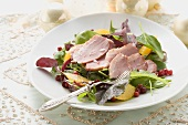 Salad leaves with smoked duck breast and orange segments