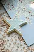 Blue star biscuit on Christmas card