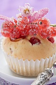 Redcurrant muffin with sugared redcurrants and flowers