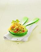 Spaghetti salad on salad servers