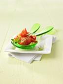 Tomato salad on salad servers