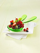 Berry salad on salad servers