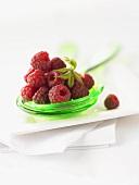 Fresh raspberries on salad servers