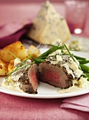 Peppered steak with Stilton and roast potatoes