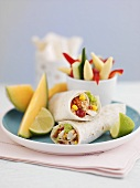 Prawn and vegetable wraps with melon wedges for lunch