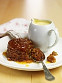Ginger pudding and small jug of custard