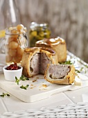 Pork pies with pickled onions and gherkins