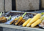 Grilled corn on the cob on a snack stall