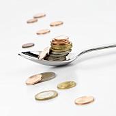 Euro coins on spoon