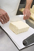 Packing butter in paper