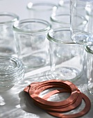 Empty jam jars and rubber rings