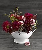 Autumnal flower arrangement in porcelain vase