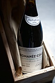 Bottle of red wine (Romanée-Conti, 1990 vintage) in wooden box