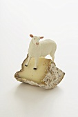 Piece of cheese (Brebis) with model sheep