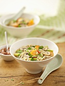 Asian-style vegetable soup with egg noodles