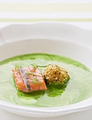 Herb soup with salmon and herring croquette