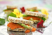 Caviar and asparagus sandwiches with nasturtium flowers