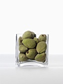 Unshelled almonds in glass bowl