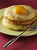 Pancakes with cheese and fried egg