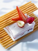 Ice cream dessert with berries and wafer rolls