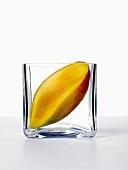 Half a mango in a glass dish