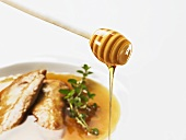 Chicken breast in honey sauce with oregano, honey dipper