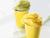 Mango ice cream and pistachio ice cream in yellow tubs
