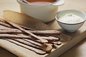 Almond sticks, rose hip soup and cream