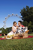Couple picnicking in the Prater (Vienna, Austria)