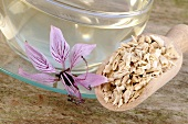 Cup of dittany tea, dried root and flower
