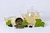 Blackcurrant leaf tea, tea leaves and blackcurrants