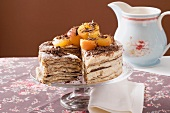 Oblatentorte (wafer cake) with coffee cream & apricots, a piece cut