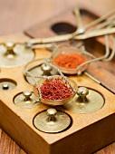 Saffron threads and saffron powder in scale pans